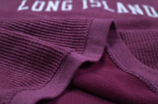 Close up of a maroon sweatshirt