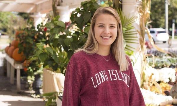 blonde girl wearing red sweatshirt