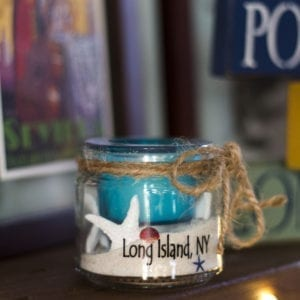 blue candle in glass jar