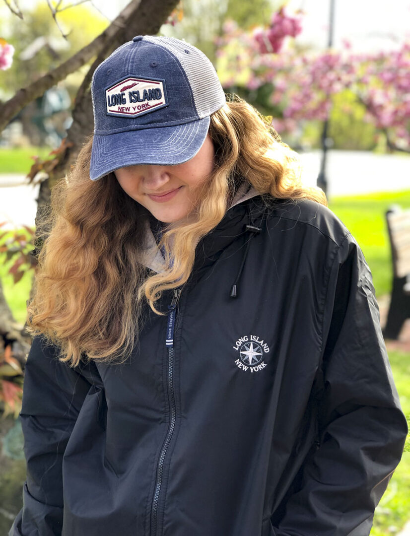 Close up of a girl wearing a cap and a black hoodie