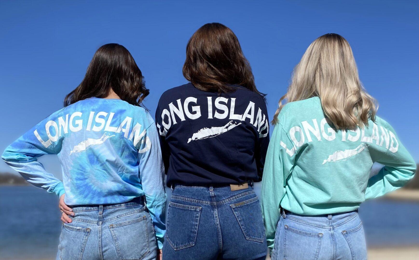 three young ladies wearing big back long island long sleeve