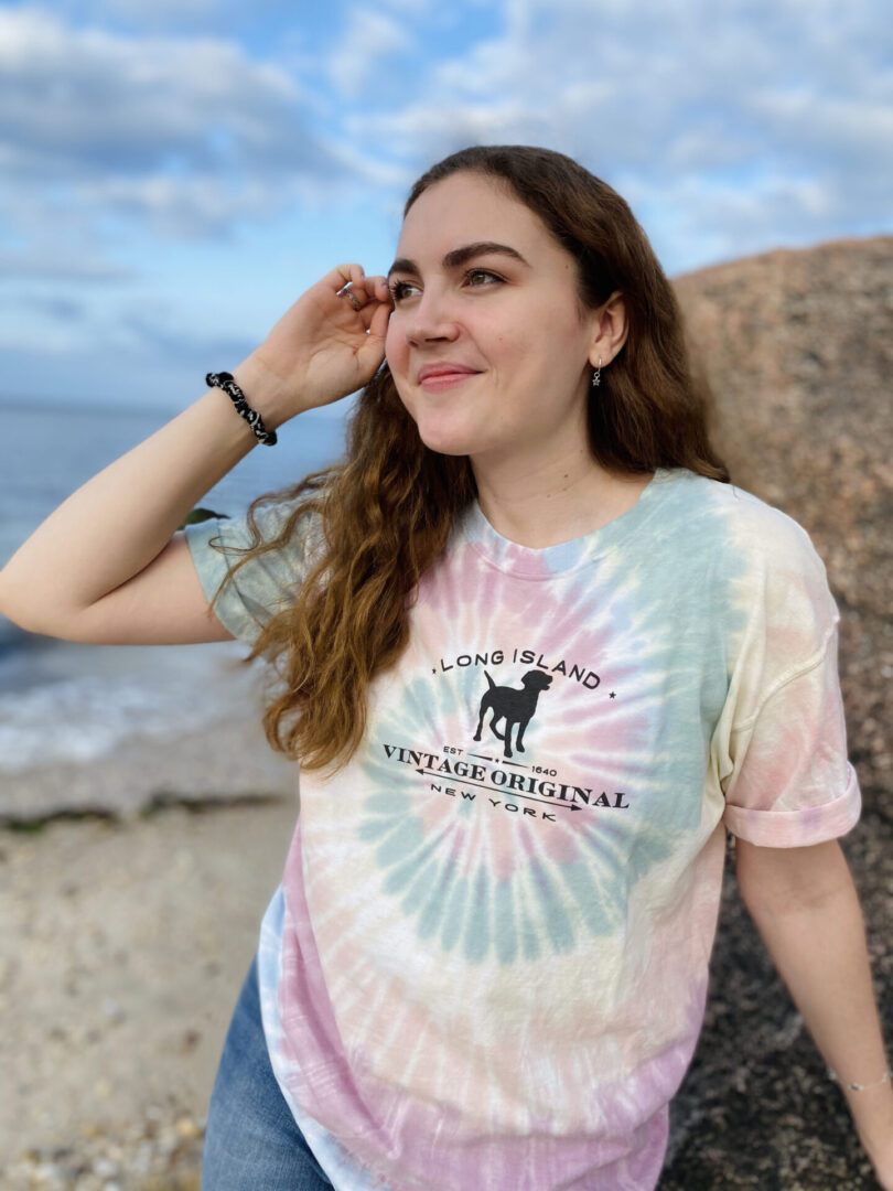 woman posing in a sherbert spiral tshirt with a lab on it