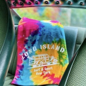 Tie-Dye Blanket in a car that reflects color on the back windshield