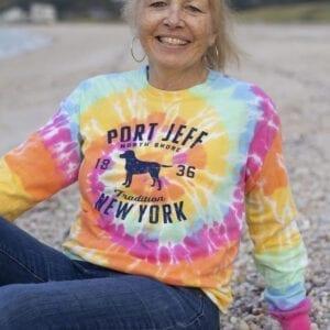 woman wearing a long sleeve sherbert tye-dye color with port jeff pup